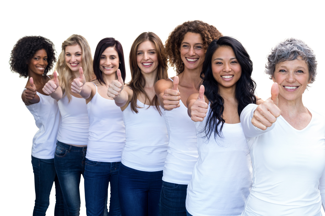 Happy multiethnic women standing in a line and showing thumbs up